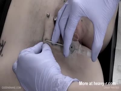 Insanely pierced pussy and tits